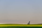 Lone pump jack in a field