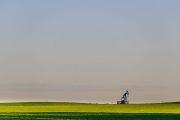 Lone pump jack in a field
