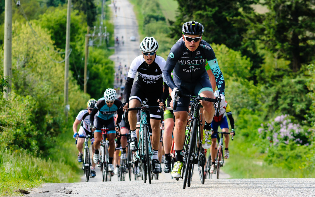 Photo of cyclists racing up a hill